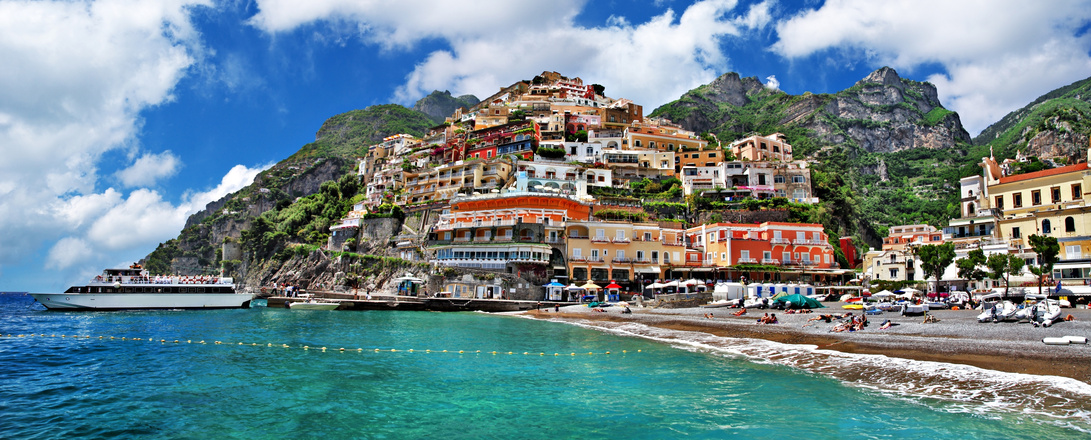 Visit the small picturesque Positano village, a cascade of small colorful houses that descend towards the sea